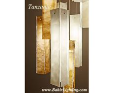Tanzania; Handcrafted blown and fused glass pendant lighting. It's not just lighting. It's Art. Available from Bahir Lighting in your choice of quantity, size and color. 612-343-2000