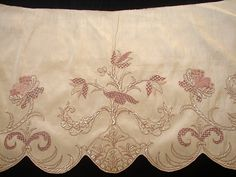 Apron front, 18th century. Cream silk worked with pink silk embroidered threads and Mother of Pearl bugle beads with a design of flowers with assorted needlepoint and checkered fillings.