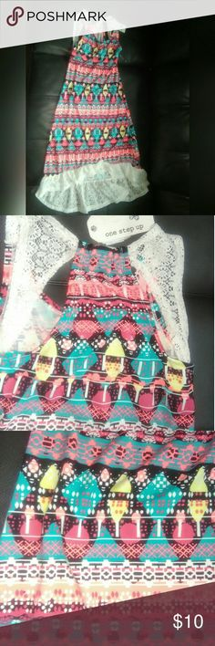 Girls New Hi-Lo Geometric Print Dress This new with tags girls hi-lo geometric print dress is perfect a perfect mix of shades of white, peach light blue, turquoise, black,  yellow, pink, and orange. The Polyester Spandex Blend Dress by One Step Up is a great addition to your lil girls wardrobe. Don't wait. Grab this dress before it is gone. This item has been cross posted. Accessories or additional items shown in the picture are not sold with this item. One Step Up Dresses Casual