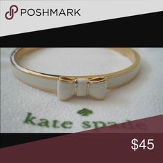 Kate spade bow bracelet white nwt Brand new pretty Kate spade bracelet! White with gold trim. Has bow. Comes with tags and dust bag and box kate spade Jewelry Bracelets