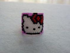 Aqui teneis la version sencilla del colgante de Hello Kitty usando los tupis de Swarovski, es la version plana disponible en la web: http://www.abalorios-tup...