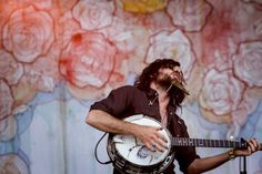 Scott Avett, of the Avett Brothers band, performs during the 2012 Bonnaroo Music and Arts Festival in Manchester, Tenn., June 8, 2012. The event's 700 acres of former farmland hosted more than 100 bands, dozens of comedians and 80,000 people to hear them over four days.