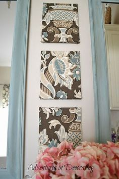 Wrap fabric over inexpensive canvas and attach to otherwise boring cabinet... GREAT IDEA!
