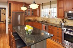 shaker cabinets, granite counters, yellow tile