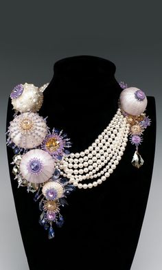 Multi-Strand Necklace with Swarovski Elements and Shells: This is STUNNING! The big round things make me think of sea anemone and makes me want to make a sea anemone style necklace. Maybe decorating Styrofoam balls and attaching them to the necklace? Going to have to play around with that.