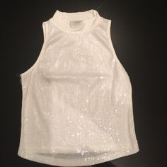 White, flashy, sleeveless top. It's a great summer top and looks great with a pair of black bottoms or jeans. Perfect for a night out in the town! Bozzolo Tops Tank Tops
