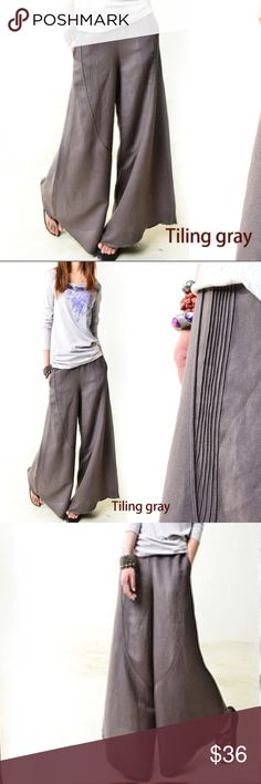 Wide Leg Trousers in Gray Fun Gray Wide Leg Trousers in an unlined Lightweight 90%Poly / 10%Spandex blend.  This is a new Boutique item in original packaging but without tags.   Please review all photos and comments prior to purchasing.  Two front pockets hidden in side seams and zipper closure hidden on left seam.   This item is labeled as a 2XL but overseas manufacturer has noted it runs about 2 sizes smaller than typical US sizes so I have sized it a Large in posting.  Waist measurement…