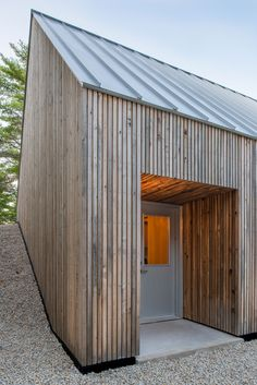 Canadian architect Omar Gandhi has completed a wooden cabin for two artists that appears to be climbing up a hill in rural Nova Scotia | Tiny Homes