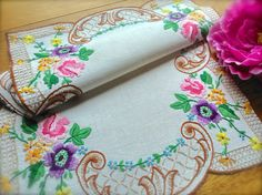 Check out this item in my Etsy shop https://www.etsy.com/uk/listing/507649366/hand-embroidered-vintage-floral-linen