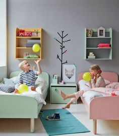 Not so keen on the pink (though my older son would love it) but love the idea of having identical beds and shelves for each child, but in different colours.