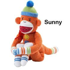 "Sunny is a large, charming, orange knit sock monkey with detailed stitching and magnets in his hands and feet. Posing him is easy, and he can even be attached to a metal object with his magnetic ability! Sunny measures 22"" tall. For ages 3 and up.    ( I have this sock monkey!)"