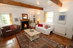 This traditional white-washed Cornish Cottage stands in the heart of the pretty village of Little Petherick. Inside its quirky layout, Ball Cottage boasts a wealth of character complemented by contemporary twists. Sleeps 6. From £365 per week.  http://www.cornishcottageholidays.co.uk/html/property_detail.php?pid=1252