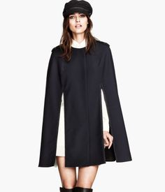 Looking for that statement piece for the fall season? Take a peek at this stunning black cape from H! This $99 piece is classic with braided detailing on the shoulders and a satin lining. It's the perfect throw-on for those windy fall days. Image from hm.com.