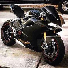 BLACK ON BLACK. DoubleTap for Ducati! #superbikes2015 #universalbikers #black #ducati #panigale #stealth #like #bikelife #followme #follow  @bikertv @panigalekings @divinebikers @thebikedoctor