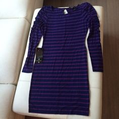 Navy & Purple Bebe Dress  Cute Jersey Dress w/scrunchy arm details... Just been sitting in my closet... Ready for a new home... Never worn... Bebe Dresses Long Sleeve