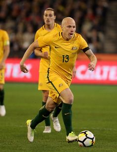 Aaron Mooy of Australia runs with the ball during the Brasil Global Tour match between Australian Socceroos and Brazil at Melbourne Cricket Ground on June 13, 2017 in Melbourne, Australia.