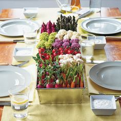 Create an hors d'oeuvre centerpiece that recalls a vegetable patch. Fill a galvanized-metal planter with tomatoes, carrots, radishes, asparagus, and cauliflower.