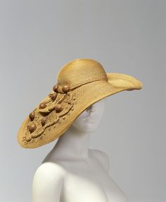 This straw hat decorated with half walnut shells and sequins was designed in Sydney by Henriette Lamotte of Sydney between 1935 and 1940. Until it was demolished to make way for new buildings in 1973, tiny Rowe Street, between Pitt and Castlereagh streets in the city centre, was considered the heart...