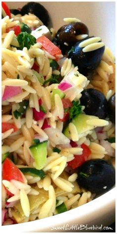 GREEK ORZO SALAD - AWESOME tried and true Recipe - Colorful, light, refreshing pasta salad loaded with artichokes, tomatoes, black olives, cucumber, red onion, feta, fresh parsley...a great one to have in your recipe box! | SweetLittleBluebird.com