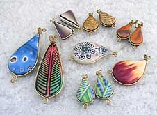 Desiree's Polymer Clay Gallery #5 - Loose Beads. A collection of various clay beads with brass wire wraps