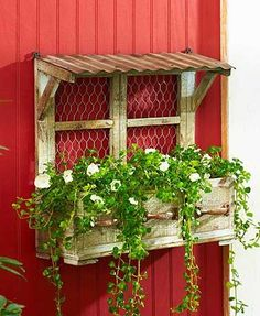 This Rustic Wall Planter will be a great addition to your outdoor space this season! It uses chicken wire and a metal roof to add a quaint country look. The Dra