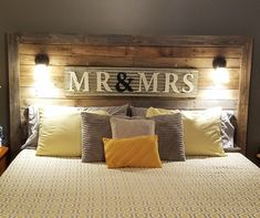 My hubby made us a king size pallet bed, added our Mr & Mrs sign, then wired our lights and attached them to the headboard. I am in love!!!!