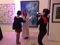 Tanya Baxter being interviewed about my work behind her April 2013 at The Saatchi Gallery