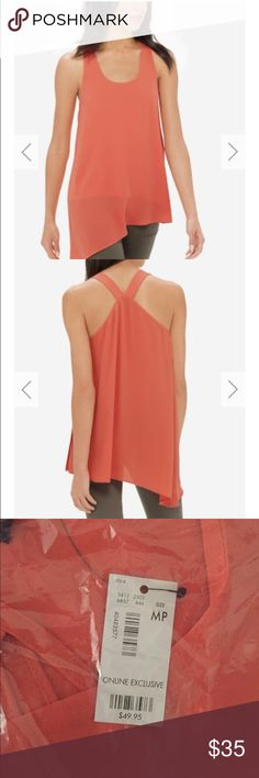The Limited Drapey Asymmetrical Top PRODUCT DETAILS An easy drape and layered wrap-look front are form flattering and everyday chic. ITEM# 341368576460705 Drapey crepe Layered front Asymmetrical hem 100% Polyester Machine wash. Tumble dry. Imported The Limited Tops