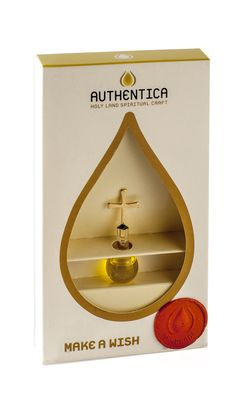 Authentica Olive Oil from the Holy Land | Yardenit.com Hand-made drop glass filled with olive oil sealed with a golden cross.  Somewhere in the Holy Land, not far from the Jordan River stands the studio of artist Oren sagi, who specialized in unifying blown-glass with metal.