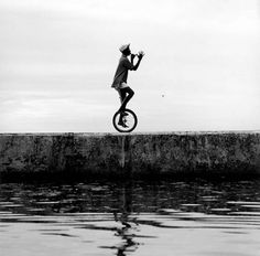 Unicycle on the edge.
