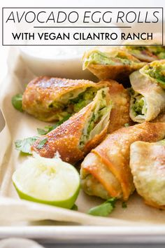 Avocado Egg Rolls with Vegan Cilantro Ranch - This Savory Vegan These Avocado Egg Rolls with Vegan Cilantro Ranch are the perfect party appetizer! Perfectly crispy, simple to make and totally tasty! Vegan Appetizers, Vegan Dinner Recipes, Appetizer Recipes, Whole Food Recipes, Vegetarian Recipes, Cooking Recipes, Healthy Recipes, Vegan Avocado Recipes, Avacado Snacks