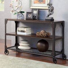 Truly modern with an industrial appeal, this stylish sofa table will bring any living space up to date. A wooden table top is supported by a sturdy metal frame, with a metal grid open shelf for storage and organization. Caster wheels add a decorative touch, as well as providing movability.