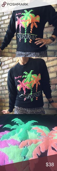 Vintage 90's Neon Monterey Cali fitted sweatshirt In vintage condition. Almost 30 years old!! Graphics are this and bubbled out-- very cool! Mark on right sleeve that will probably come out in the wash. I took a picture of it. It's a pilling a little bit, not too bad considering its age. Definitely a small- or XS not a medium anymore Vintage Tops Sweatshirts & Hoodies