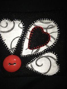 felt background with cutwork, blanket stitch and appliqué