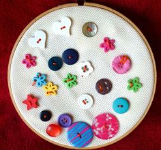 upgrade from the toddler sewing basket with drawer liner - this time with embroidery fabric, buttons, and a blunt needle and floss.