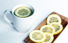 Drinking warm lemon water early in the morning