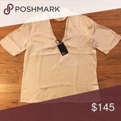 Paige Cateline Silk V-Cutout Top Front and back V-cutout. Machine wash or dry clean. 100% Silk. PAIGE Tops Blouses