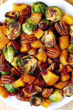 Roasted Brussels Sprout Dish: Cinnamon-y butternut squash, pecans, and cranberries make your roasted brussels sprouts ready for fall.