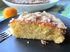 Almond Olive Oil Cake. Ingredients: flour, almond meal, baking powder, salt, eggs, sugar, olive oil, vanilla extract, almond extract, orange zest, orange juice. Glaze: confectioner's sugar, milk, orange juice, sliced almonds. Recipe on Stacey Snacks.