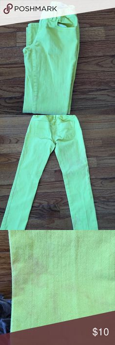 Neon yellow (chartreuse) jeans Gap super skinny jeans. There are some places on the jeans where something has bled into them but since it's on both legs it appears as if they're made that way GAP Bottoms Jeans