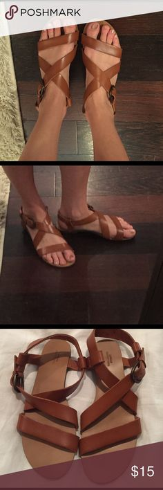 Urban Outfitters Leather Sandals Super cute and trendy brown leather sandals from Urban Outfitters. Criss cross straps with buckle on side. Size 8. Very comfy and in great condition! I'm only selling because they're slightly too big for me. Fits true to size. Urban Outfitters Shoes Sandals