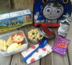 Annie's mac and cheese with spinach, apples with Stonyfield Greek yogurt and peanut butter dip, fruit snacks, milk, and a Stonyfield tube of yogurt.  Lunch created by Denise from Wholesome Mommy.