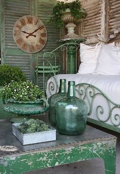 Shabby Chic Cottage - Inspiring & Dreamy. LOVE The clock and the shutters that it hangs on. The distressed table is super cute too! #shabbychic