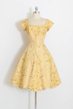 ➳ vintage 1950s dress * golden silk taffeta * lace overlays * acetate lining * beautiful beading and rhinestones * metal back zipper * scalloped hem condition | excellent - some of the lace overlays are lifting just a bit. fits like l/xl length 43 bodice 15 bust 38-40 waist 33-34 ➳ shop http://www.etsy.com/shop/millstreetvintage?ref=si_shop ➳ shop policies http://www.etsy.com/shop/millstreetvintage/policy twitter | MillStVintage fac...