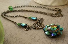 Vintage assemblage necklace peacock ab crystal margarita bead blues and greens brass ox components one-of-a-kind Triolette jewelry by triolette on Etsy