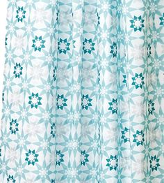 This quilt-like shower curtain pattern is protected with a water-repellent coating that helps prevent mildew. About $13; IKEA