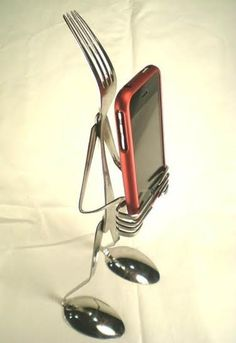 iPhone stand made from cutlery.