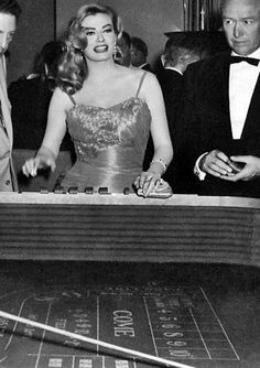 Now that's a beautiful sight.. Anita Ekberg at the Craps table... her or the Craps table?? Learn more at: http://www.playerscasinoclub.com
