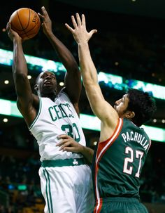 BOSTON, MA - DECEMBER 03: Brandon Bass #30 of the Boston Celtics takes a shot over Zaza Pachulia #27 of the Milwaukee Bucks in the first quarter during the game at TD Garden on December 3, 2013 in Boston, Massachusetts. (Photo by Jared Wickerham/Getty Images)