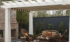 Outdoor living room  Landscape architect Brian Sublette designed a unique outdoor courtyard that includes a pergola with a retractable canopy using fabric by Sunbrella, which is great for protection from sun and rain. Comfy seating is placed near a fireplace to create an outdoor living area that is great for parties and entertaining.